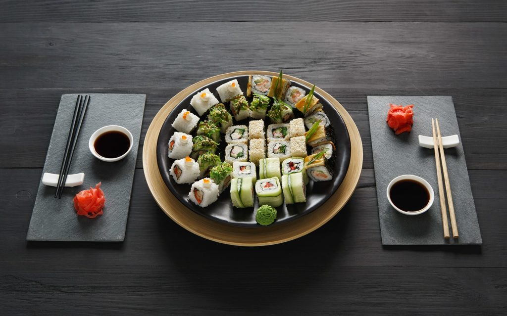 set-of-sushi-maki-and-rolls-at-black-rustic-wood-P9ARWRU-min